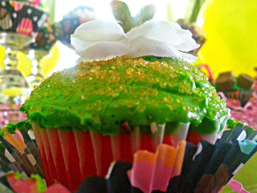 Five bright colored cupcakes
